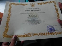 Pak Wawans certificate of most improved productivity from the Governor of West Java